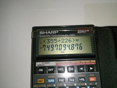 tan(355/226)