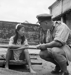 A Chinese girl from one of the Japanese Armys comfort battalions sits on a stretcher