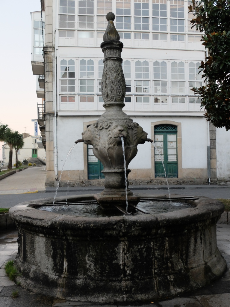 Old lion statue in Melide