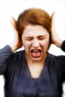 5107812-noise-and-stress-concept--woman-covering-her-ears.jpg
